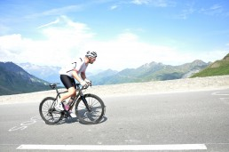 man cycling uphill with nice scenic background