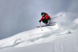 Person jumping and skiing